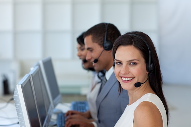 Smiling businesswoman in a call canter