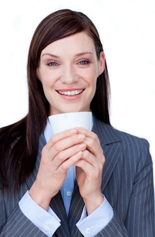 Smiling businesswoman drinking a tea