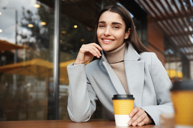 Smiling businesswoman having a rest in a coffee shop.