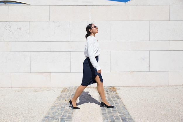 Smiling businesswoman on her way to office