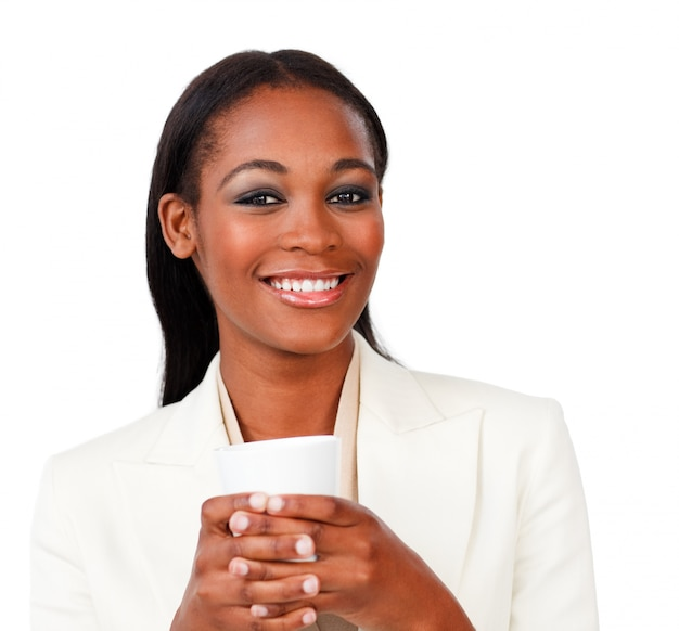 Smiling businesswoman holding a drinking cup