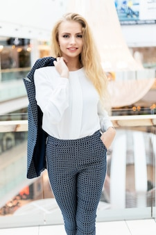 Smiling businesswoman portrait in a bright modern office