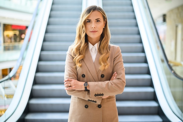 Smiling businesswoman portrait in front of mobile stairs