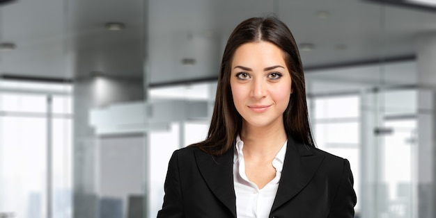 Smiling businesswoman portrait in a modern office
