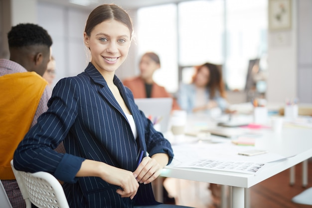 Smiling businesswoman posing in production agency