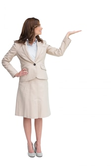Smiling businesswoman raising her hand