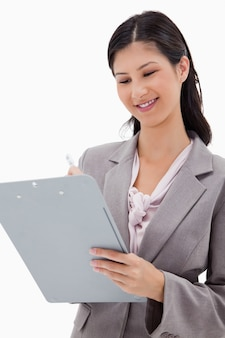 Smiling businesswoman with clipboard