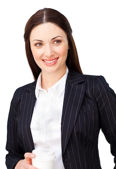 Smiling businesswoman with a drinking cup