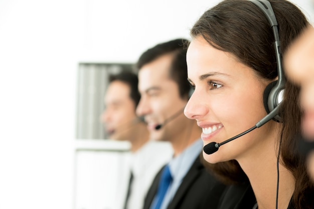 Smiling call center (or telemarketer) team