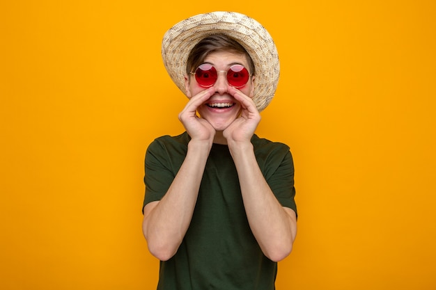 Smiling calling someone young handsome guy wearing hat with glasses
