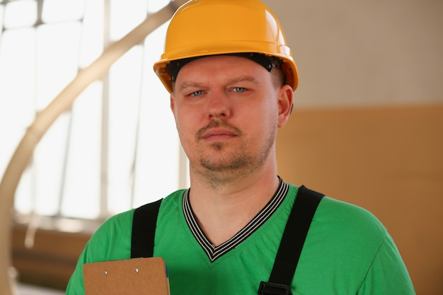 Smiling carpenter holding clipboard