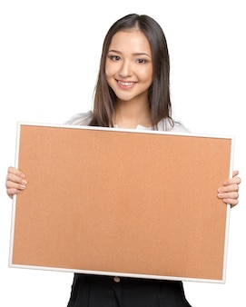 Smiling casual woman holding the empty corkboard