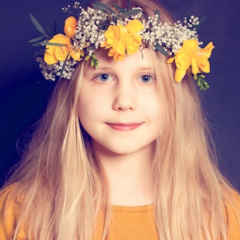 Smiling child girl with yellow flowers