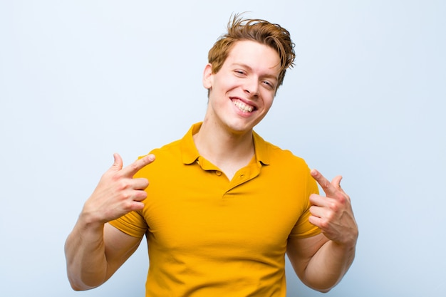 Smiling confidently pointing to own broad smile, positive, relaxed, satisfied attitude