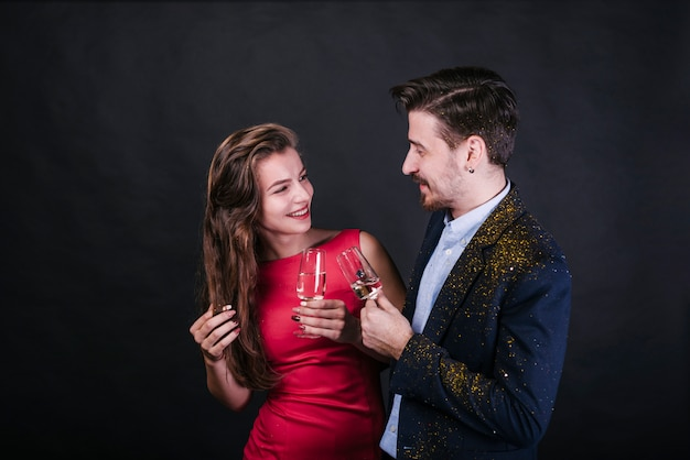 Smiling couple holding glasses of champagne