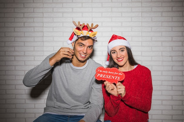 Smiling couple posing with christmas decor