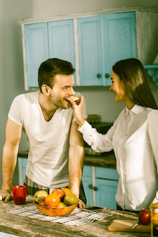 Smiling couple preparation food at home kitchen