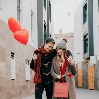 Smiling couple walking on date