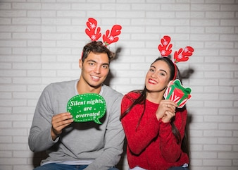 Smiling couple with Christmas decorations