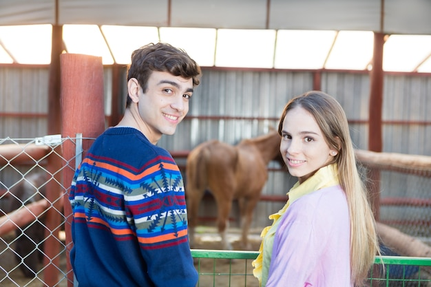 Smiling couple with an horse