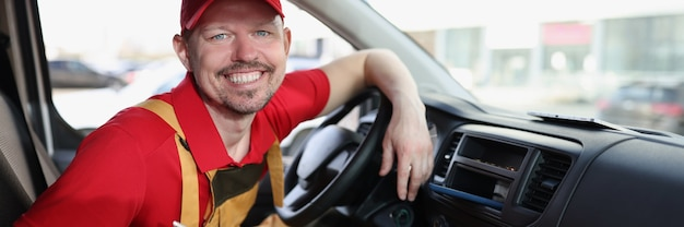 Smiling courier with clipboard on the driver seat of car