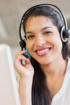 Smiling customer service representative wearing headset