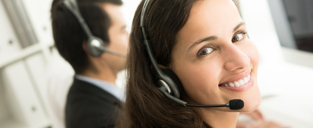 Smiling customer service staff in call center