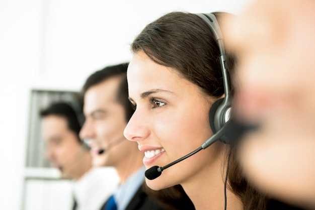 Smiling customer service team in call center