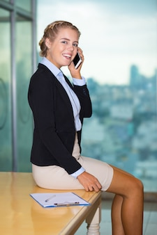 Smiling Cute Young Business Lady Talking on Phone