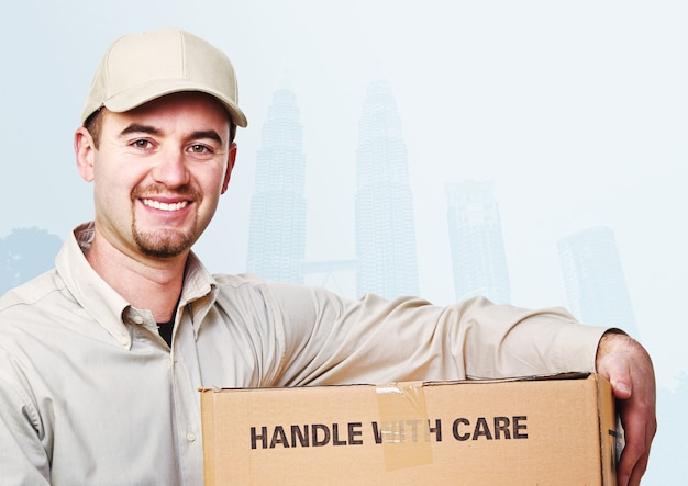 Smiling delivery man and asian town background