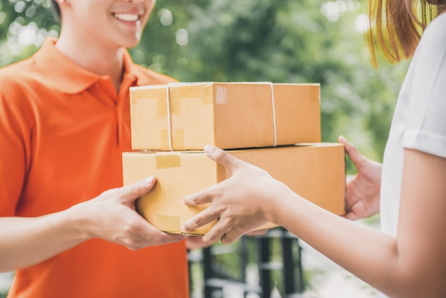 Smiling delivery man delivering parcel to a woman
