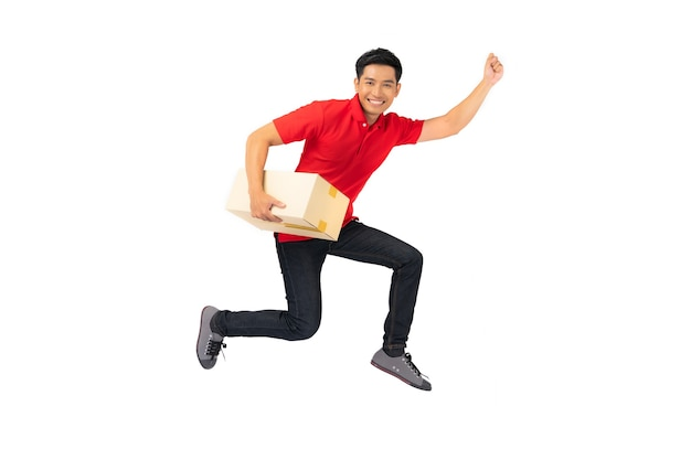 Smiling delivery man employee in blank t-shirt uniform jumping with parcel post box isolated