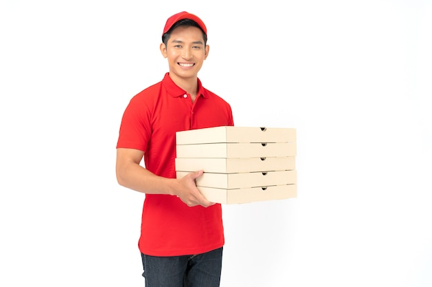 Smiling delivery man employee in red cap blank t-shirt uniform standing