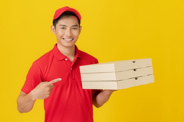 Smiling delivery man employee in red cap blank t-shirt uniform