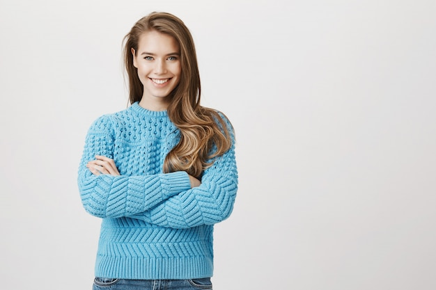 Smiling determined woman cross arms chest confident