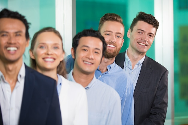 Smiling diverse business people standing in row