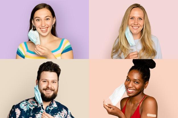 Sorridenti persone diverse che si tolgono la maschera facciale nella nuova normalità