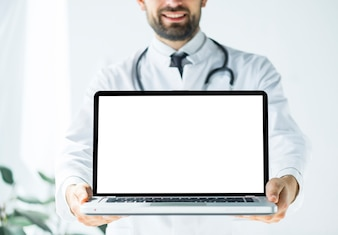 Smiling doctor demonstrating laptop