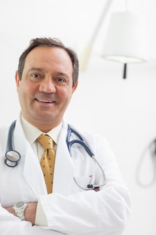 Smiling doctor folding his arms