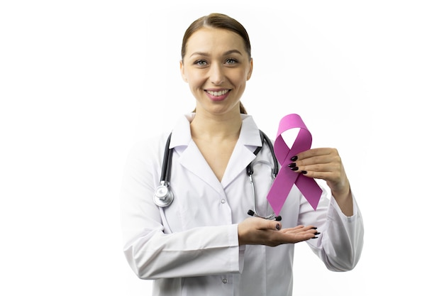 Smiling doctor in white coat shows pink ribbon breast cancer awareness campaigns