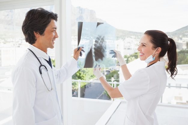 Smiling doctors holding an x ray