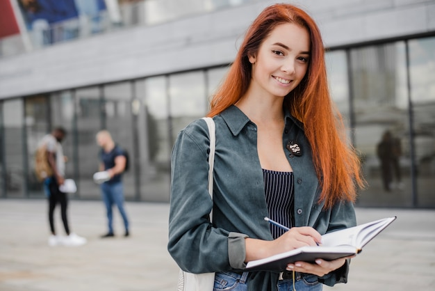 Smiling elegant woman with notebook