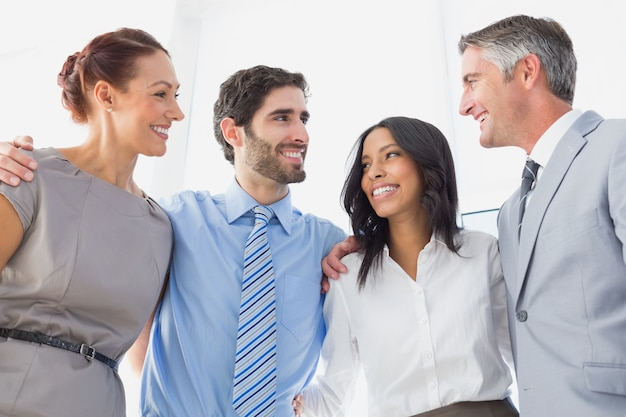 Smiling employee's standing all together at work