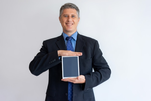 Smiling executive sharing information on tablet screen