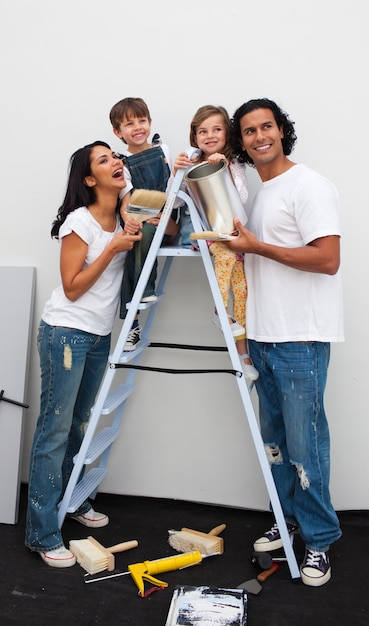 Smiling family painting a room