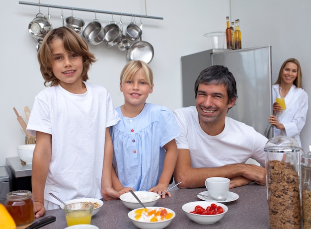 Smiling family preparing breakfast