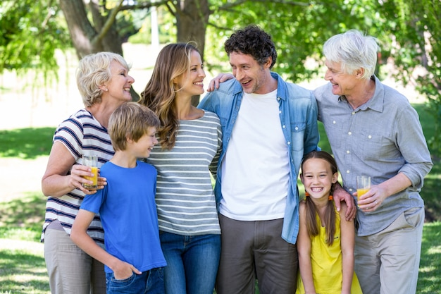 Smiling family standing