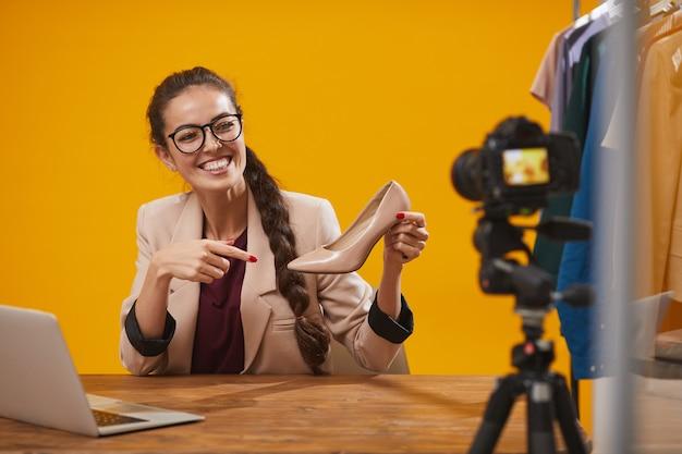 Smiling fashion blogger fiming video