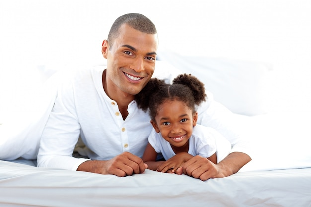 Smiling father and his daughter having fun