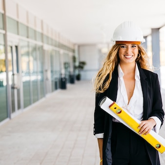 Smiling female architect with helmet
